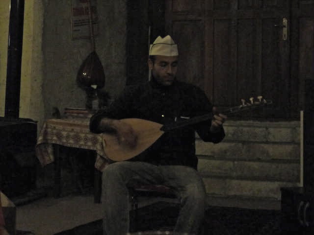 The chef and brother of our new friend, plays the guitar and sings for us after dinner