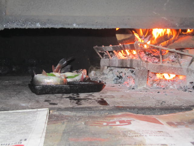 Fish baking in the wood burning oven