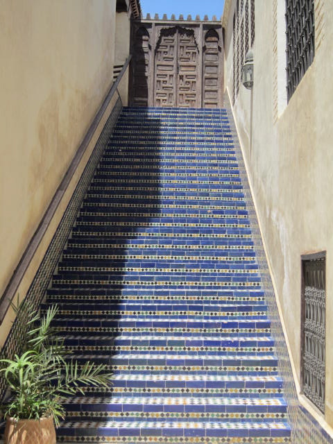 Blue steps leading from the University to the Library