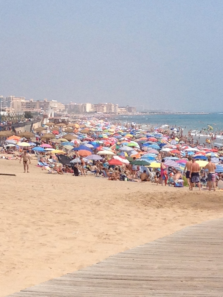 The beach was a tad crowded, won't you say?