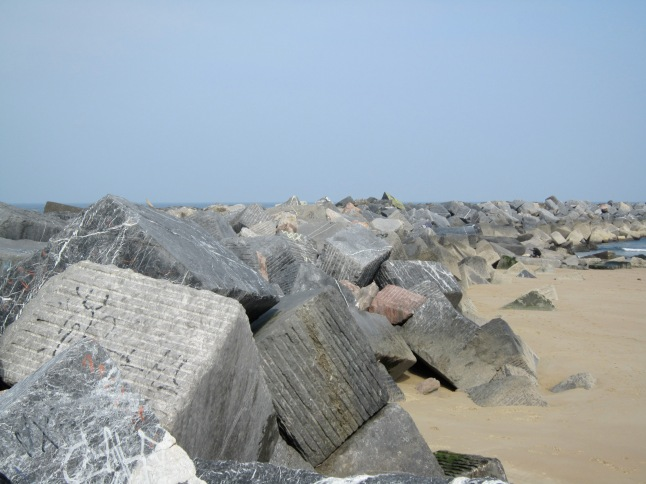 Interested decision to include stone cubes on the beach