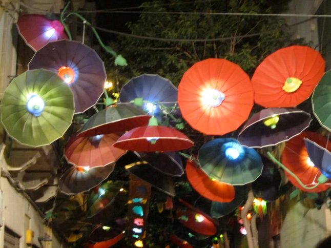 Look closely, flowers made from umbrellas with colanders and tea cups