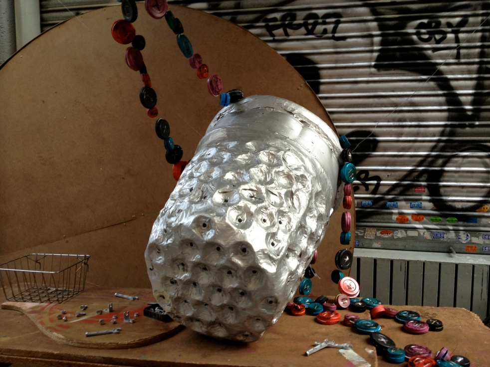Thimble and buttons made out of tobacco cans